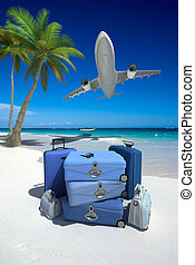 Perfect tropical vacation - Pile of blue luggage on a...