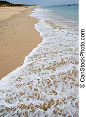 Waterline - The sea washing the beach sand