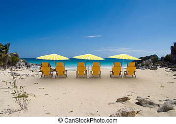 Yellow sunshade cove - Tropical cove with white and yellow...