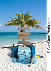 Tropical beach vacations directions - Pile of luggage and...