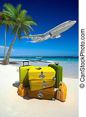Perfect beach vacation - Pile of yellow luggage on a...