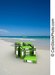 Green folders on the beach - 3D rendering of green ring...