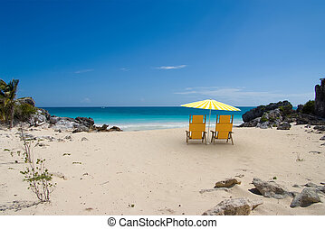 Perfect retirement - Tropical beach with sunshade and a pair...