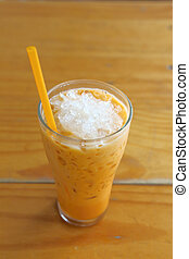 Ice tea - milk Ice tea on wood table