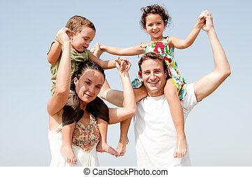 family - Parents with children sitting on the shoulders