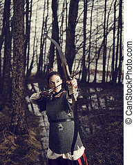 Medieval archery, woman shoot - Medieval archer woman, she...