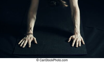 Downward Facing Dog Pose - Yoga practitioner performing adho...