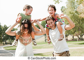 Happy young family - Young couple embracing and enjoying...