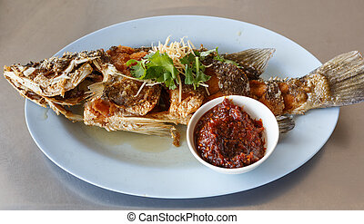 Fried snapper on blue dish