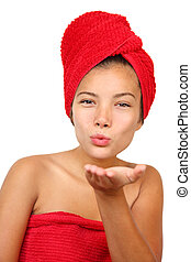 Woman Blowing kiss - Woman blowing a finger kiss at the...