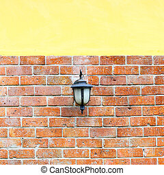 lantern for light on brick wall