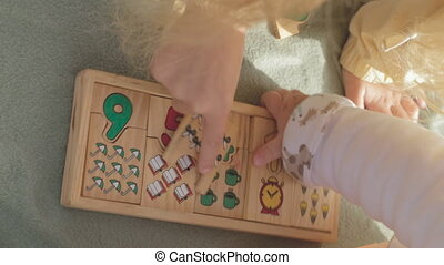 Close-up of wooden developing game with numbers on nature