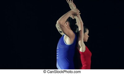 Supported Back Arch - Standing back to back one partner is...