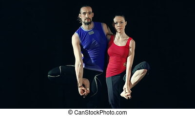 Double Tree Pose - Close up of partners standing beside each...