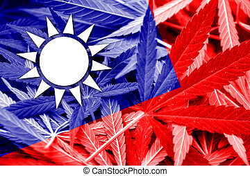Taiwan Flag on cannabis background. Drug policy....