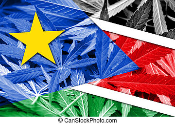 South Sudan Flag on cannabis background. Drug policy....