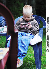 playing games - young boy play games on phone