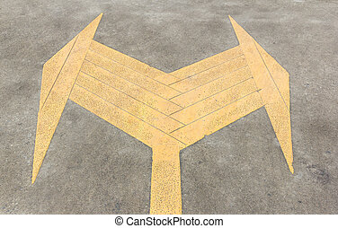 Left and right arrow sign on the road