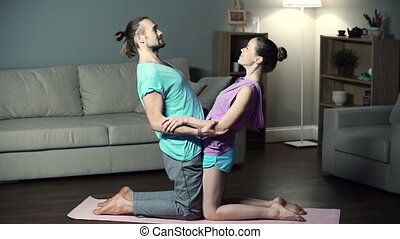 Double Backbend - Partner yoga pose when partners perform...