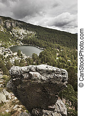 Landscape with lake and pine forest in Spain Laguna Negra...