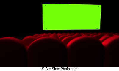 Cinema screen with green screen and open red seats