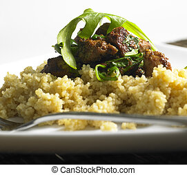 chicken meat with rucola on couscous