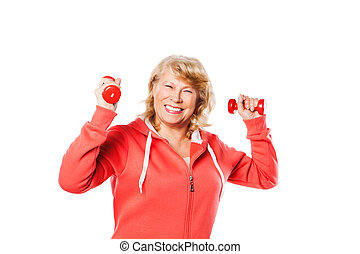 Happy senior woman making fitness training with dumbbells -...
