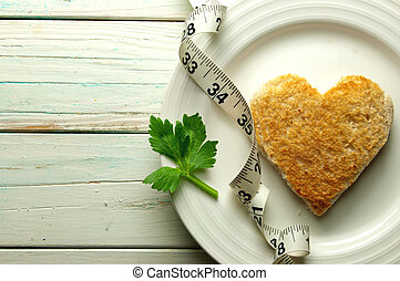 Healthy heart toast - Heart shape toast on a plate with...