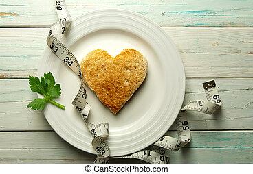 Healthy heart toast - Heart shape toast on a plate with tape...