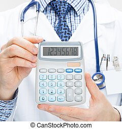 Doctor holding calculator in hands - health care concept - studi
