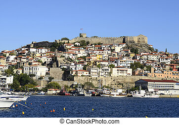 Greece, Kavala, harbor with homes, imaret, castle and...