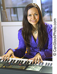 pianist - happy young pianist with sequencer on a studio