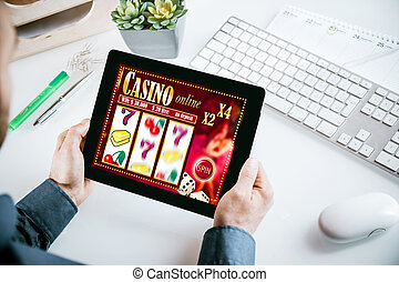 Online casino gambling interface on a tablet showing lucky...