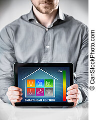 Man with Tablet Showing Home Control Display - Close up...