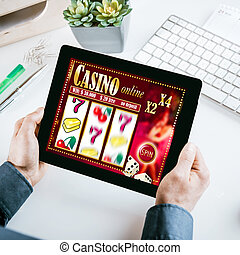 Online gambling concept with a businessman seated at his...