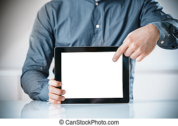 Businessman pointing to a blank screen of a tablet -...