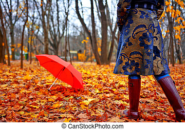 Autumn Wear - Woman with rubber boots and autumn coat...