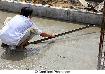 a plasterer concrete worker at floor work