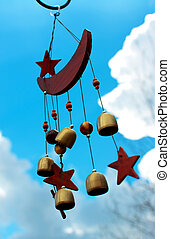 Wind Chimes - Moon and stars wind chimes with blue sky...
