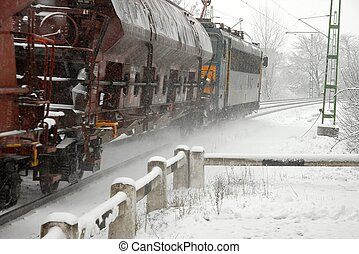 Train - Freight train passing by in falling snow with some...
