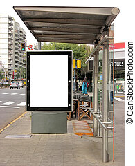 Board on bus stop - Publicity board on a bus stop, street on...