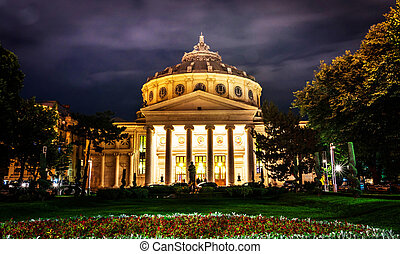 Bucharest Athenaeum building on a cloudy night.