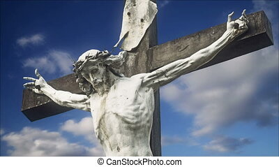 Crucifixion Statue with Time Lapse Clouds in background,...