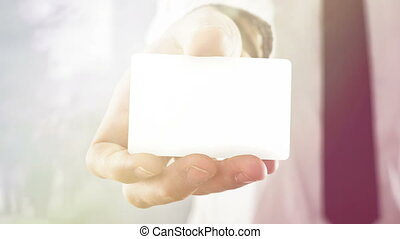 Businessman holding visiting card - Businessman holding...