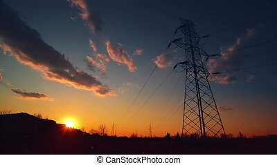Silhouette of Electric Pylon and Power line in sunset, Time...