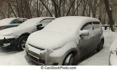 Cars covered with snow on parking - NOVOSIBIRSK, RUSSIA, -...
