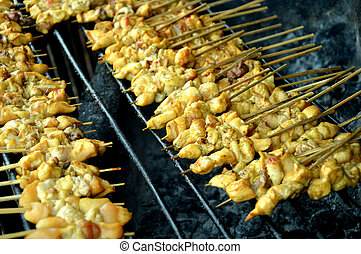 satay - row of satay on the furnace