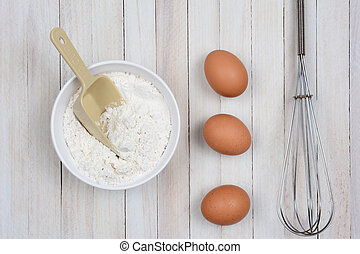 Bowl of Flour Eggs and Whisk