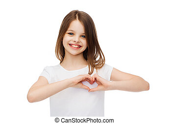 smiling little girl showing heart with hands - friendship,...