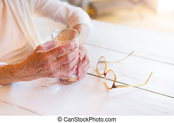 Senior woman - Hands of unrecognizable senior woman holding...